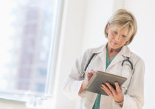 Doctor Using Digital Tablet In Hospital Royalty Free Stock Photo