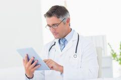 Doctor using digital tablet Stock Image