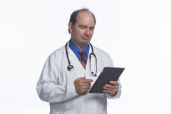 Doctor using electronic tablet, horizontal Royalty Free Stock Photos