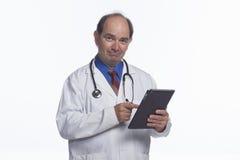 Doctor using electronic tablet, horizontal Stock Photo