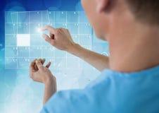 Doctor using futuristic touchscreen Stock Photo