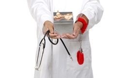 Doctor using handcuffs to debate healthcare reform Royalty Free Stock Photography