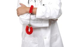 Doctor using handcuufs to debate healthcare reform Royalty Free Stock Images