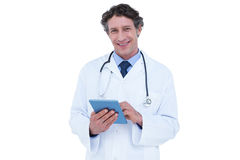Doctor using his digital tablet Stock Photography