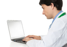 Doctor using his laptop computer. Portrait of a doctor using his laptop computer Royalty Free Stock Image