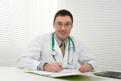 Doctor using his laptop computer Royalty Free Stock Image