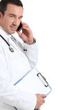 Doctor using his phone Royalty Free Stock Photography
