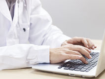 Doctor using laptop Stock Photo