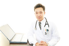 Doctor using laptop Royalty Free Stock Image