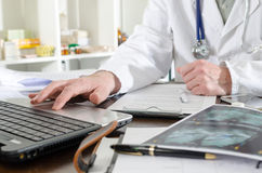 Doctor using a laptop Stock Photo