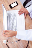 Doctor using laptop Stock Photography