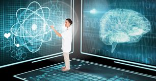 Doctor using medical interface in 3D room Stock Photos