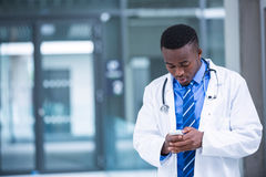 Doctor using mobile phone royalty free stock image