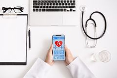 Doctor using smartphone app to check health data royalty free stock photos