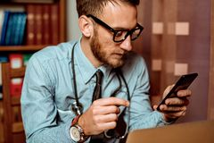 Doctor using smartphone royalty free stock photography