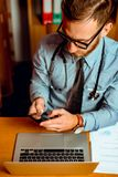 Doctor using smartphone stock photography