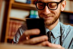 Doctor using smartphone royalty free stock photo