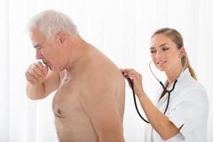 Doctor Using Stethoscope On Patient`s Back Royalty Free Stock Images