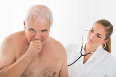 Doctor Using Stethoscope On Patient`s Back Stock Photography