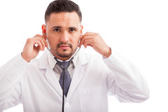 Doctor using a stethoscope Stock Photo