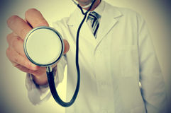 Doctor using a stethoscope, with a retro effect Royalty Free Stock Photo