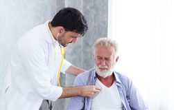 Doctor is using a stethoscope to check heart of senior patient. Healh care and medical concept consultation between doctor and patient Royalty Free Stock Image