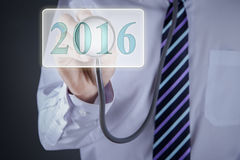 Doctor using stethoscope to touch numbers 2016 Stock Photos