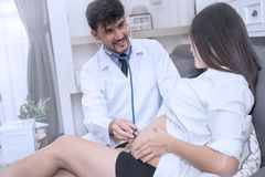 Doctor using stethoscope white examining pregnant woman Stock Image