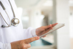 Doctor using tablet computer Stock Images