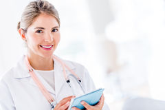 Doctor using tablet computer Stock Photography