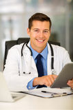 Doctor using tablet computer. Modern doctor using tablet computer in office Stock Photos