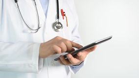 Doctor using tablet. For browsing information in hospital stock footage