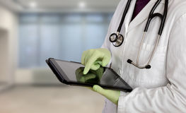 Doctor using tablet in hospital Stock Photos