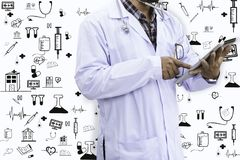 Doctor. Is using tablet and icon stock photos