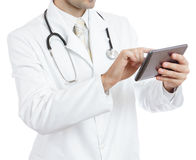 Doctor using tablet. Isolated on white Royalty Free Stock Photos
