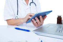 Doctor using a tablet in the office. Close up plan of a doctor using a tablet on a white background Royalty Free Stock Image