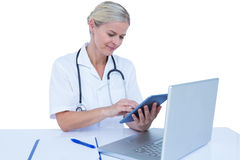 A doctor using tablet in the office Stock Images