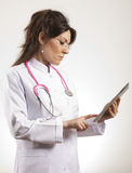 Doctor using tablet pc Stock Photo