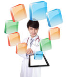 Doctor using tablet pc with colorful icon Royalty Free Stock Photos