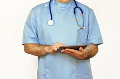 Doctor using a tablet PC, isolated Royalty Free Stock Photography