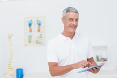 Doctor using tablet pc Stock Image