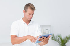 Doctor using tablet pc. In medical office Royalty Free Stock Photo