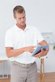 Doctor using tablet pc Stock Photography