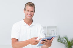 Doctor using tablet pc. In medical office Royalty Free Stock Image