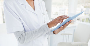 Doctor using a tablet pc Stock Photo