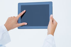 Doctor using tablet pc Royalty Free Stock Photography