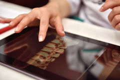 Doctor Using Tablet With X-ray Royalty Free Stock Photography