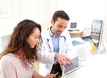 Doctor using tablet to inform patient. View of a Doctor using tablet to inform patient royalty free stock photography