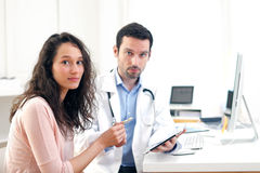 Doctor using tablet to inform patient. View of a Doctor using tablet to inform patient stock photos