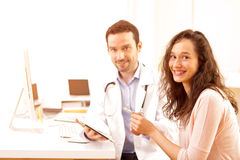 Doctor using tablet to inform patient. View of a Doctor using tablet to inform patient royalty free stock photos